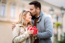 Couple in love.Man surprising his girlfriend with a gift on Valentine's Day